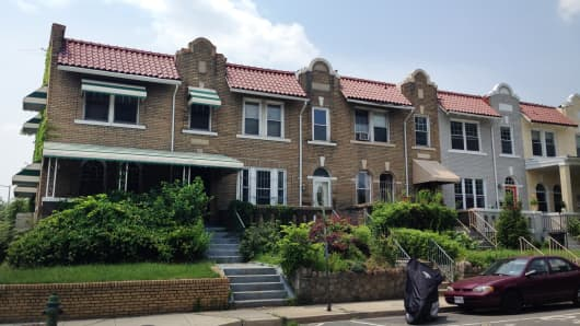 The end unit is a foreclosed, vacant home in Washington, DC's Petworth neighborhood.  RealtyTrac estimates its value at $600,117.