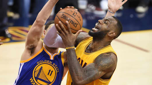 LeBron James of the Cleveland Cavaliers drives against Klay Thompson of the Golden State Warriors during Game 3 of the 2015 NBA Finals on June 9, 2015, in Cleveland.