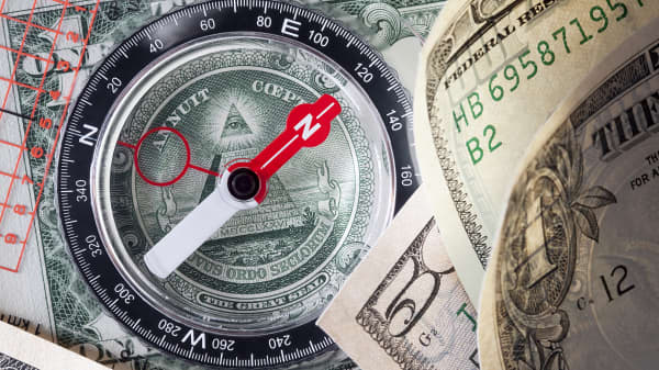 Compass on dollar bills