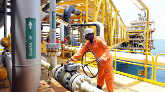 A worker inspect facilities on an upstream oil drilling platform at the Total oil platform at Amenem, 35 kilometers away from Port Harcourt in the Niger Delta in 2009.