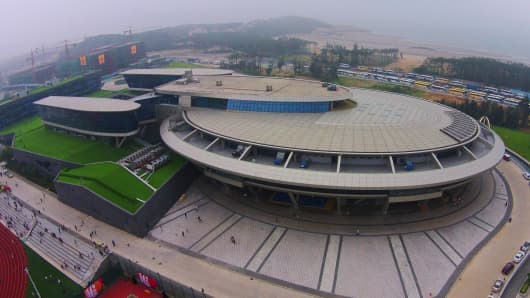"This photo shows the NetDragon Websoft headquarters building with the iconic circular contours and tubular features of the USS Enterprise, from U.S. television and film series ""Star Trek"", in Fuzhou, China."