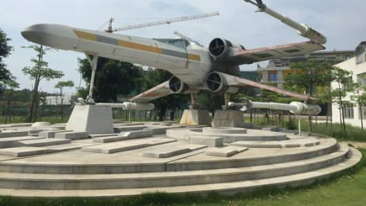 A life-size replica of a Star Wars X-wing fighter jet stands outside the headquarters of NetDragon Websoft in Fuzhou, China.