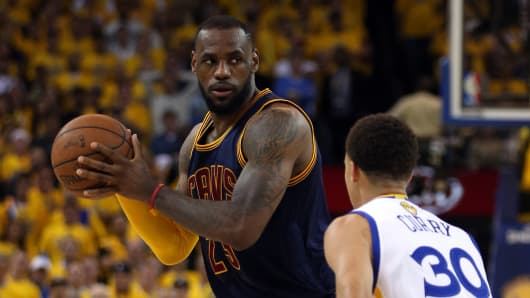 LeBron James #23 of the Cleveland Cavaliers drives against Stephen Curry #30 of the Golden State Warriors during Game One of the 2015 NBA Finals at ORACLE Arena on June 4, 2015 in Oakland, California.