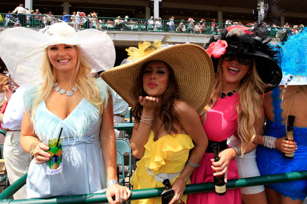Women wearing decorative hats pose for a picture prior to the 138th running of the Kentucky Derby at Churchill Downs on May 5, 2012 in Louisville, Kentucky.