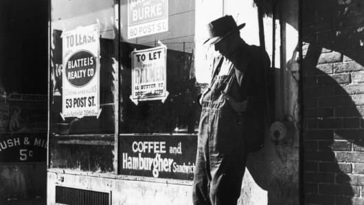 "Unemployed man stands against a vacant store on ""Skid Row,""  Howard Street, San Francisco, February 1937, in this photograph by Dorothea Lange."