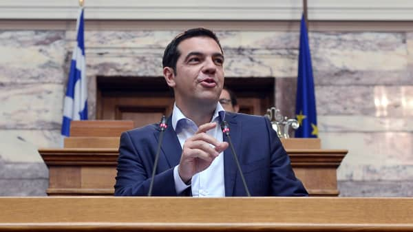 Greek Prime Minister Alexis Tsipras addresses his MP's and ministers at the Greek Parliament in Athens on June 16, 2015. Tsipras charged the International Monetary Fund had 'criminal responsibility' for Greece's debt crisis and called on the country's European creditors to assess the IMF's policies.