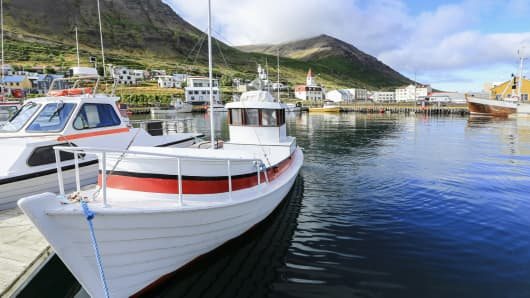 Boats moored in a harbor in Iceland.