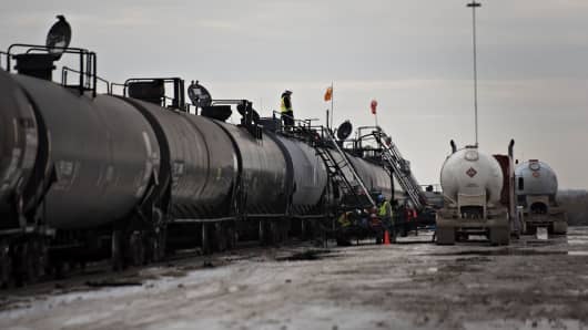 Liquid propane is transloaded from a truck to a railcar at the Red River Supply rail yard in Williston, North Dakota.