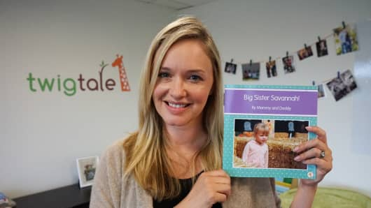 Carrie Southworth, holding one of Twigtale's books for kids, personalized for her daughter.