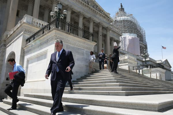 Legislators depart the U.S. Capitol building in Washington.