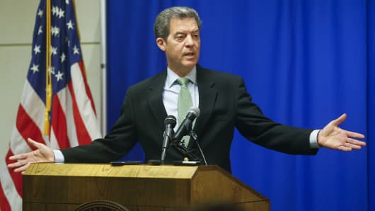 Kansas Gov. Sam Brownback addresses the media about the legislative session during a press conference on June 16, 2015, at the Kansas Statehouse in Topeka.
