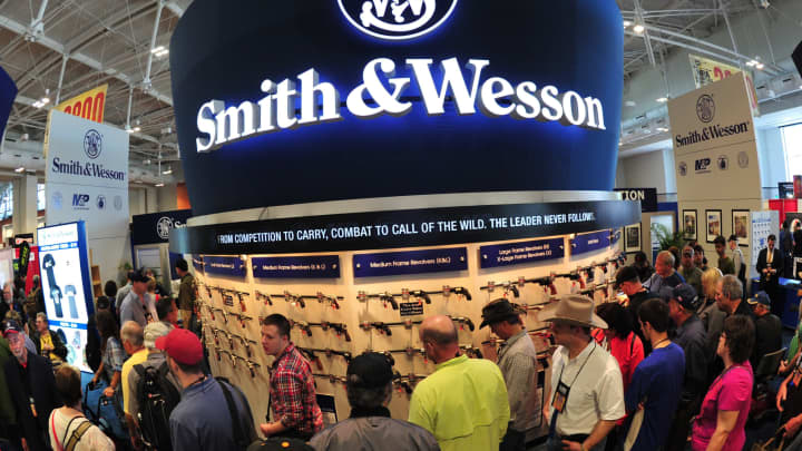 Convention goers look at weapons at the Smith and Wesson booth last April at the 2015 NRA Annual Convention in Nashville, Tenn.