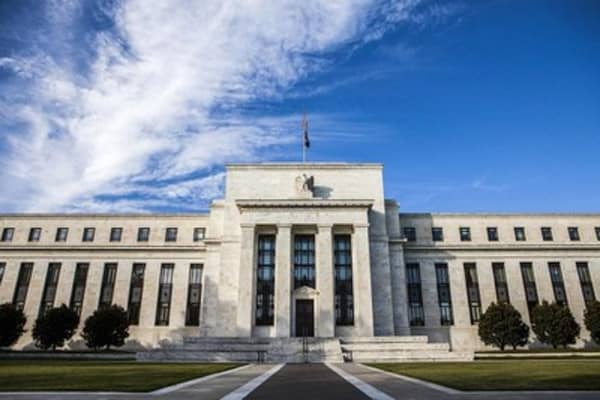Fed leaves rates unchanged, upgrades economy