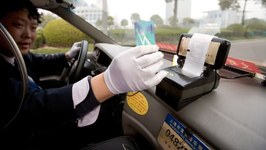 Shanghai taxi driver taking credit card payment