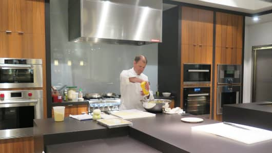 A chef cooks in Pirch's test kitchen at the Garden State Plaza mall in Paramus, New Jersey.