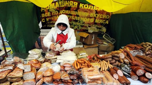 A vendor sells meat products during the International Agro-industrial exhibition 'Agrorus 2014' in Saint Petersburg on August 27, 2014.