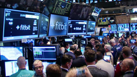 Fitbit signs and traders at the NYSE during their IPO, June 18, 2015.