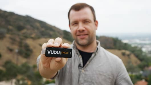 Adam Johnson, founder and CEO of Toggle, displaying the VUDU Spark
