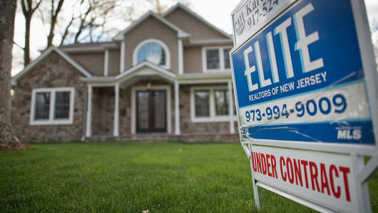 A for sale sign is displayed outside of a house in Oradell, N.J.