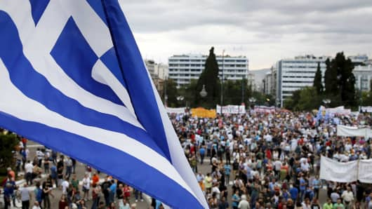 A Greek flag during a pro-government rally in front of the parliament building in Athens, Greece, June 21, 2015.