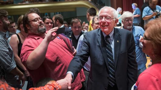 Democratic presidential hopeful Sen. Bernie Sanders greets guests at Drake University on June 12, 2015.
