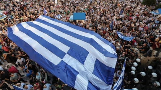 Demonstrators rally demanding on Greece remain euro zone at Sintagma Square on June 22, 2015 in Athens, Greece.
