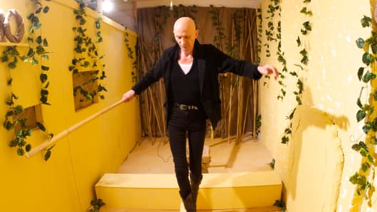 The Crystal Maze presenter Richard O'Brien tests a prototype puzzle.