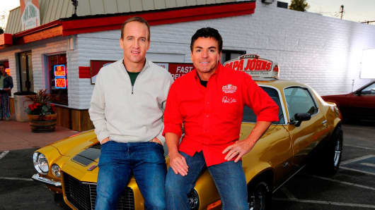 CEO and Founder of Papa John's John Schnatter, right, with Peyton Manning.