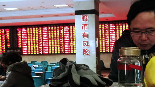 "The words ""[Playing the] stock market has its risks"" are pasted on the walls of this stock exchange corporation in Nantong, Jiangsu province of China."