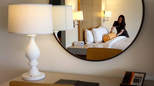 An employee prepares a room at the J.W. Marriott L.A. Live hotel in Los Angeles.