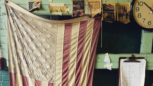 A flag on the shop floor of the Bollman Hat Co. in Adamstown, Pa.