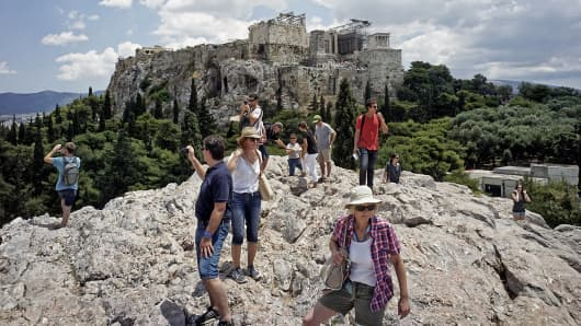 Tourists visit Acropolis Hill in Athens, June 23, 2015.