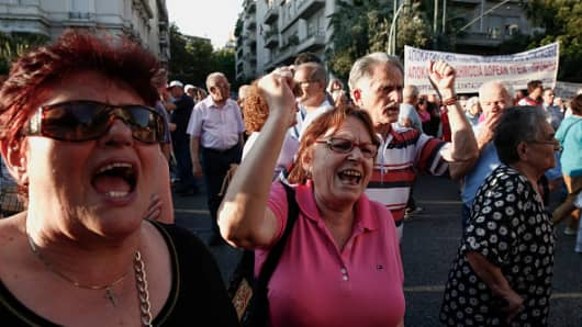 Pensioners shout slogans during a demonstration outside the Greek parliament on Syntagma square in Athens, Greece, on Tuesday, June 23, 2015.