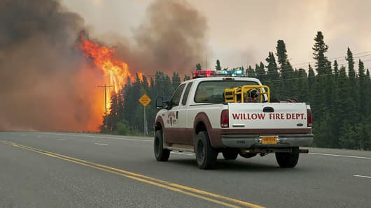 Willow Fire Capt. Leo Lashock responds to a wildfire burning near Willow, Alaska, June 14, 2015.