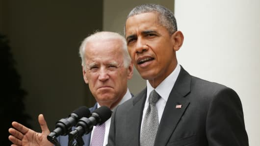 President Barack Obama, flanked by Vice President Joe Biden, gives a statement on the Supreme Court health care decision in the Rose Garden at the White House on June 25, 2015 in Washington.