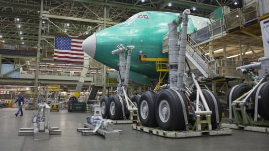 A worker walks near a 747-8 airplane at the Boeing factory in Everett, Wash.