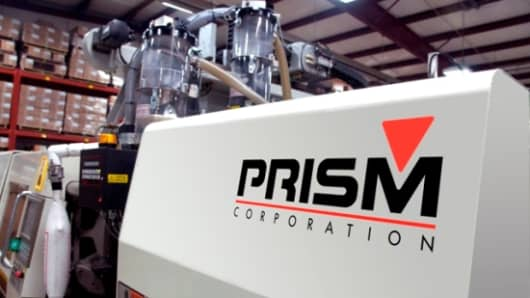 A manufacturing molding machine at Prism Plastics in Detroit. Prism represents next-gen manufacturers, characterized by leading-edge technology, innovation and entrepreneurship.
