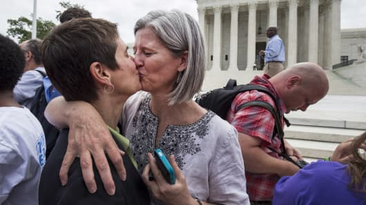 Rea Carey (L) kisses her wife Margaret Conway after the U.S. Supreme Court ruled on Friday that the U.S. Constitution provides same-sex couples the right to marry at the Supreme Court in Washington June 26, 2015.