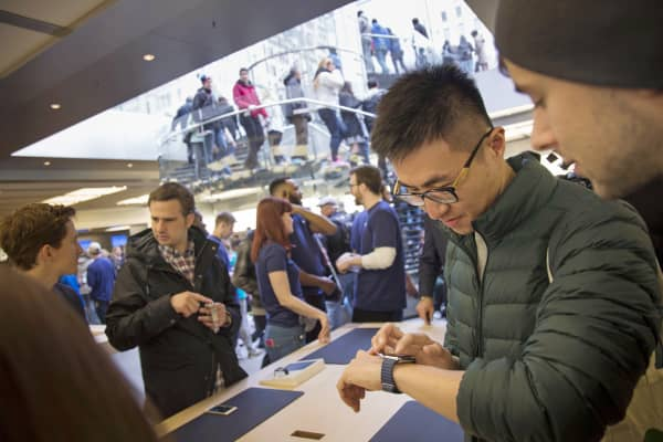 A customer tries on an Apple Watch at an Apple store in New York.