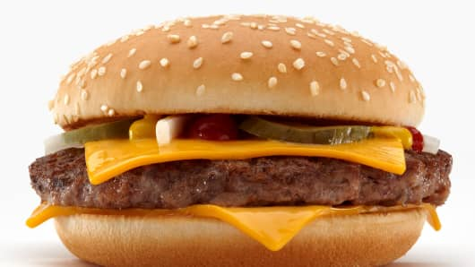 McDonald's current quarter pounder with cheese hamburger whose patty is 4 ounces before cooking.