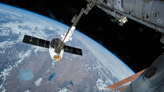 The SpaceX Dragon cargo spacecraft is shown berthed to the Harmony module of the International Space Station.