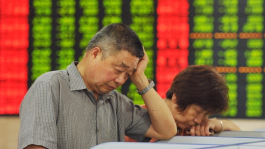 Investors observe the stock market at a stock exchange hall in Fuyang, China, June 26, 2015.