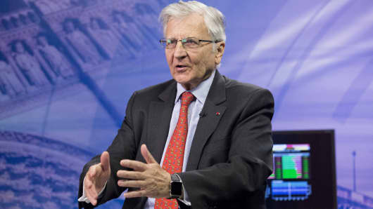 Jean-Claude Trichet, former president of the European Central Bank (ECB), gestures as he speaks during an interview in Paris.