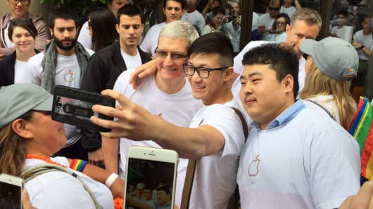 Tim Cook poses for selfies at the Pride Parade in San Francisco, June 28, 2015.