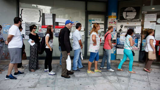 Jobseekers queue to enter an OAED employment center in Athens, Greece, last September.