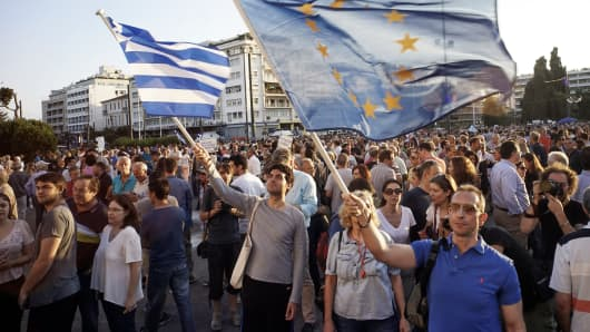 Pro-European Union protesters take part in a rally in front of the parliament on June 18, 2015 in Athens, Greece.
