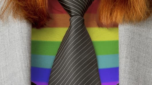 Businesswoman with rainbow-patterned top