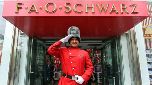 An employee dressed as a toy soldier stands outside FAO Schwarz in New York, May 18, 2015.