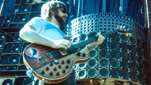 Phil Lesh of The Grateful Dead performs in front of the 'Wall of Sound' at Santa Barbara Stadium in May 1974 in Santa Barbara, Calif.
