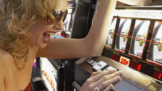 Woman winning at slot machine